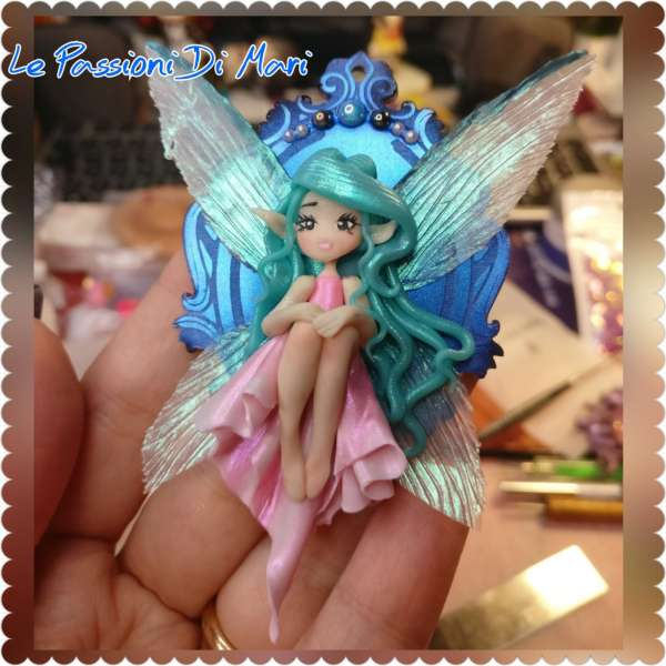 Little Fairy sitting on a shiny cameo frame handmade polymer clay, fimo