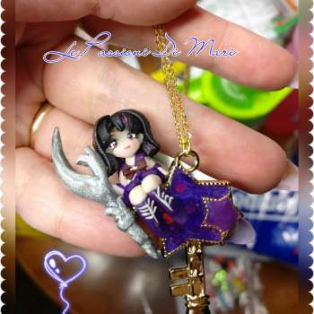 sailor Saturn Necklace sitting on a star charm bezel